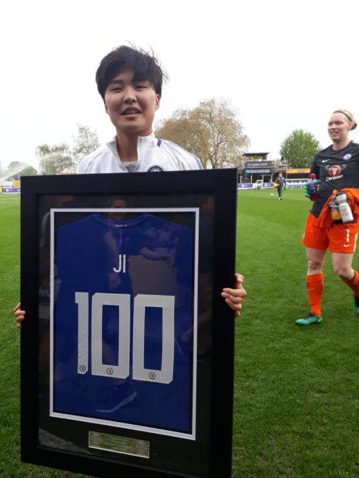 Ji So-Yun is presented with a framed shirt to mark 100 appearances, ahead of scoring a second-minute goal against Wolfsburg, as goalie Hedvig Lindahl moves in to congratulate her